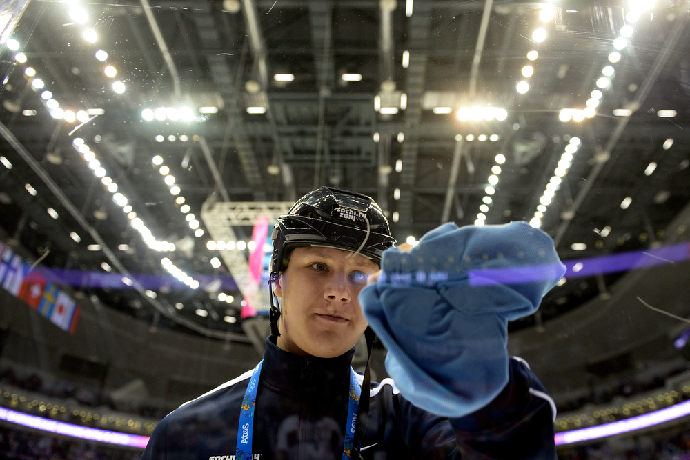 . A window cleaner wipes down the ice during the first period of men\'s hockey action at Bolshoy arena. Sochi 2014 Winter Olympics on Saturday, February 15, 2014. (Photo by AAron Ontiveroz/The Denver Post)