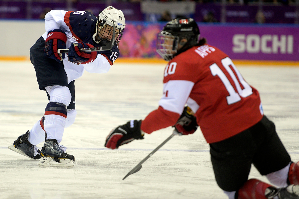 . Anne Schleper (15) of the U.S.A. takes a shot as Gillian Apps (10) of the Canada defends during the first period of the women\'s gold medal ice hockey game. Sochi 2014 Winter Olympics on Thursday, February 20, 2014 at Bolshoy Ice Arena. (Photo by AAron Ontiveroz/ The Denver Post)