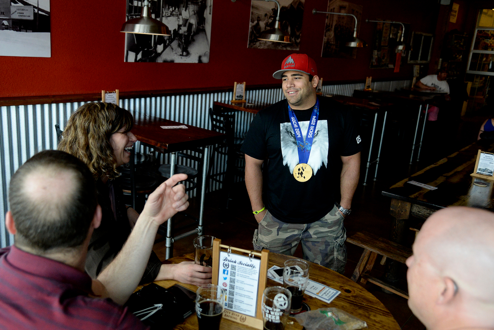 . U.S.A. Paralympics sled hockey gold medalist Nikko Landeros chats with patrons about his Olympic experiences at City Star Brewing, Berthoud, Colorado on Thursday, March 20, 2014. (Photo by AAron Ontiveroz/The Denver Post)