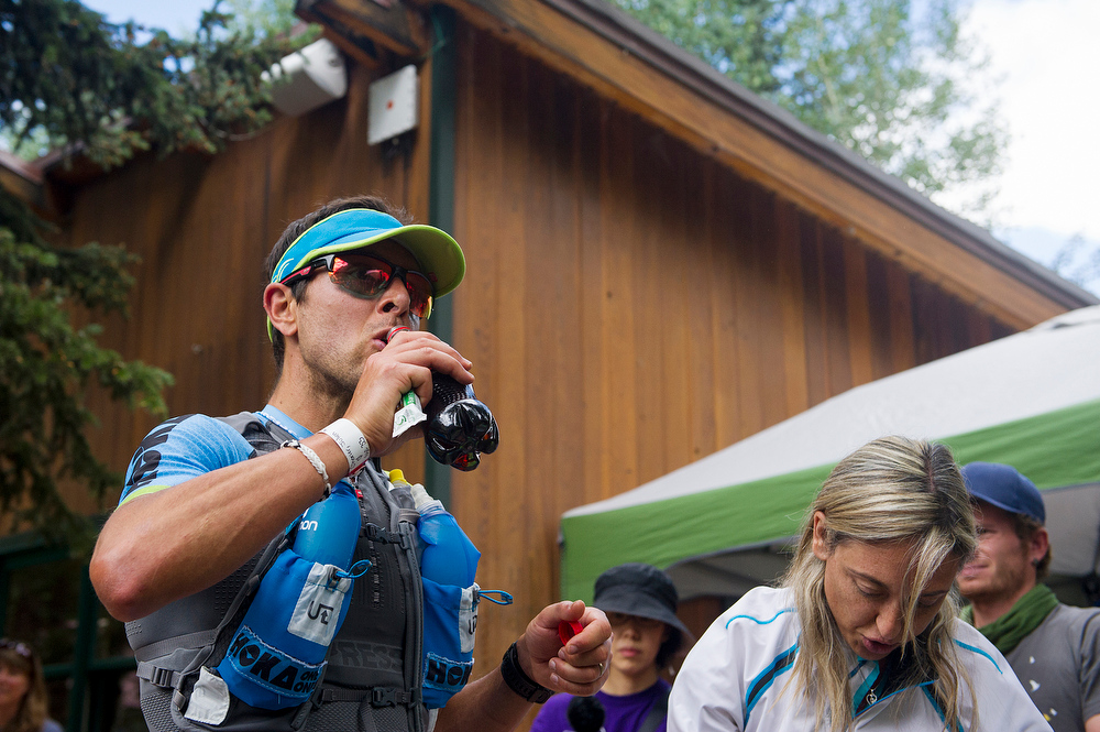 . Julien Chorier drinks a Coke in the aid station near mile 28 during the Hardrock 100 Endurance Run on July 11, 2014, in the San Juan Mountains in Telluride, Colorado. (Photo by Daniel Petty/The Denver Post)
