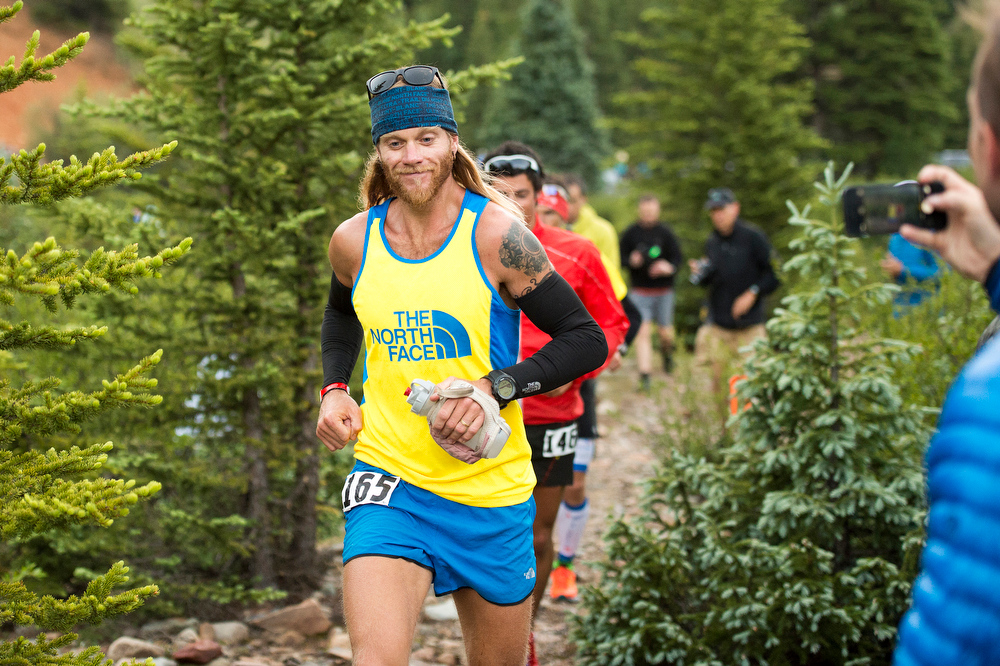 . Timothy Olson #165 prepares to enter Mineral Creek near mile two of the 100.5-mile Hardrock 100 Endurance Run on July 11, 2014, in the San Juan Mountains near Silverton, Colorado. (Photo by Daniel Petty/The Denver Post)