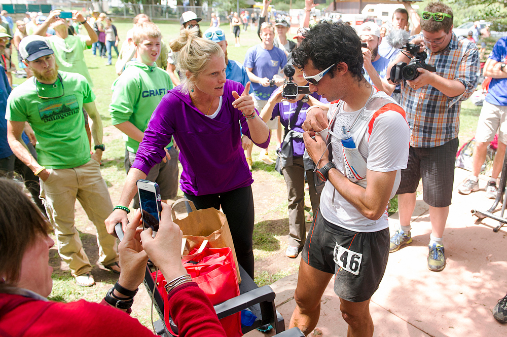 . Kilian Jornet gets directions out of the Telluride Aid Station in Town Park near mile 28 amid hordes of media after coming into the checkpoint first during the 100.5-mile Hardrock 100 Endurance Run on July 11, 2014, in the San Juan Mountains in Telluride, Colorado. (Photo by Daniel Petty/The Denver Post)