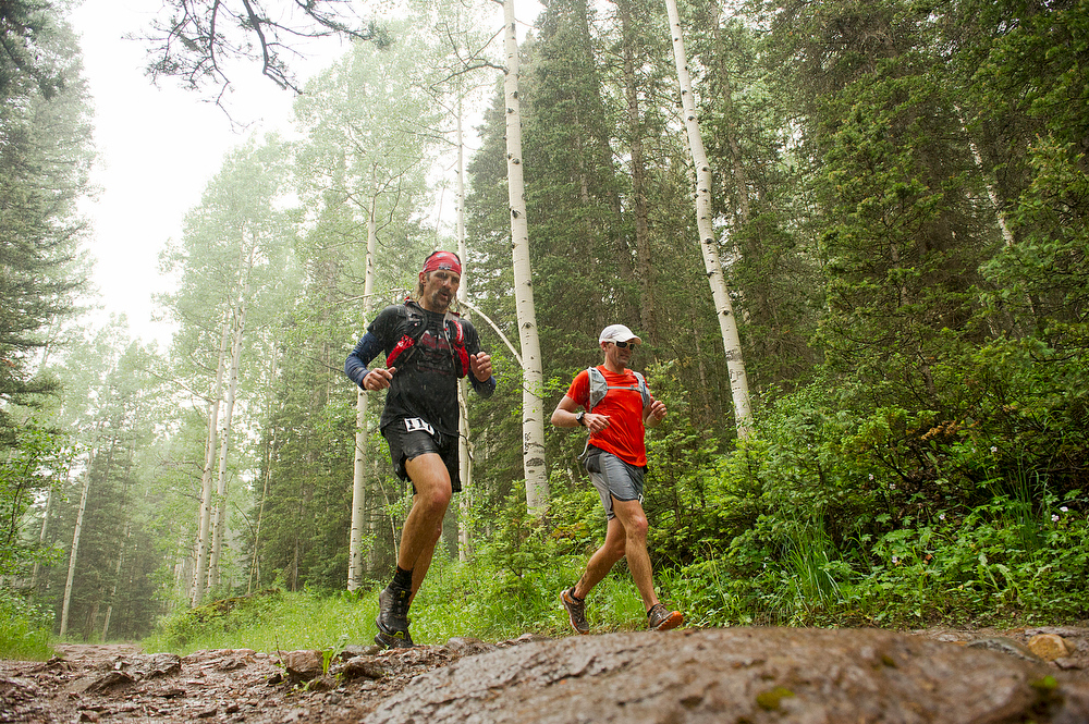 . Kevin Davis #117 and   Erich Peitzsch #168 race down into Telluride in the rain near mile 28 of the 100.5-mile Hardrock 100 Endurance Run on July 11, 2014, in the San Juan Mountains near Telluride, Colorado. (Photo by Daniel Petty/The Denver Post)