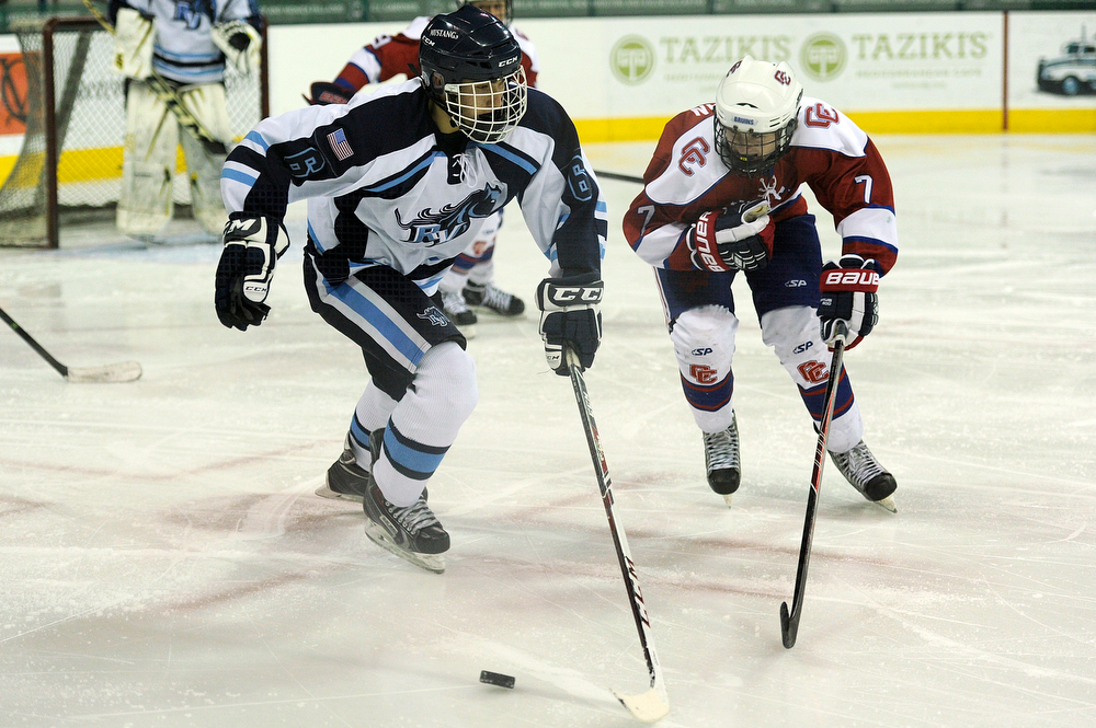 . Ralston Valley forward Cody Noel (6) goes after a puck with Cherry Creek forward Owen Berman during a CHSAA ice hockey semifinal at the Denver Coliseum on February 28, 2014, in Denver, Colorado. Ralston Valley won 6-2. (Photo by Daniel Petty/The Denver Post)