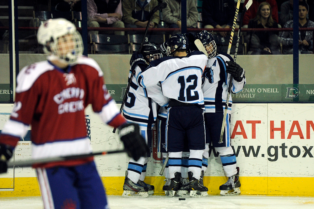 . Ralston Valley celebrates after scoring a goal during the third period against Cherry Creek in a CHSAA ice hockey semifinal at the Denver Coliseum on February 28, 2014, in Denver, Colorado. Ralston Valley won 6-2. (Photo by Daniel Petty/The Denver Post)