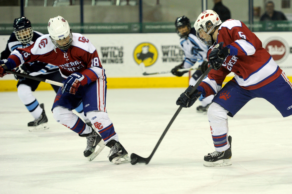 . Cherry Creek defenseman Alec Lemmon (5) skates with defenseman Martin Bakula (18) against Cherry Creek in a CHSAA ice hockey semifinal at the Denver Coliseum on February 28, 2014, in Denver, Colorado. Ralston Valley won 6-2. (Photo by Daniel Petty/The Denver Post)