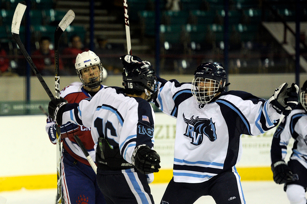 . Ralston Valley celebrates after scoring a goal during the third period against Cherry Creek during the CHSAA state ice hockey semifinal at the Denver Coliseum on February 28, 2014, in Denver, Colorado. Ralston Valley won 6-2. (Photo by Daniel Petty/The Denver Post)