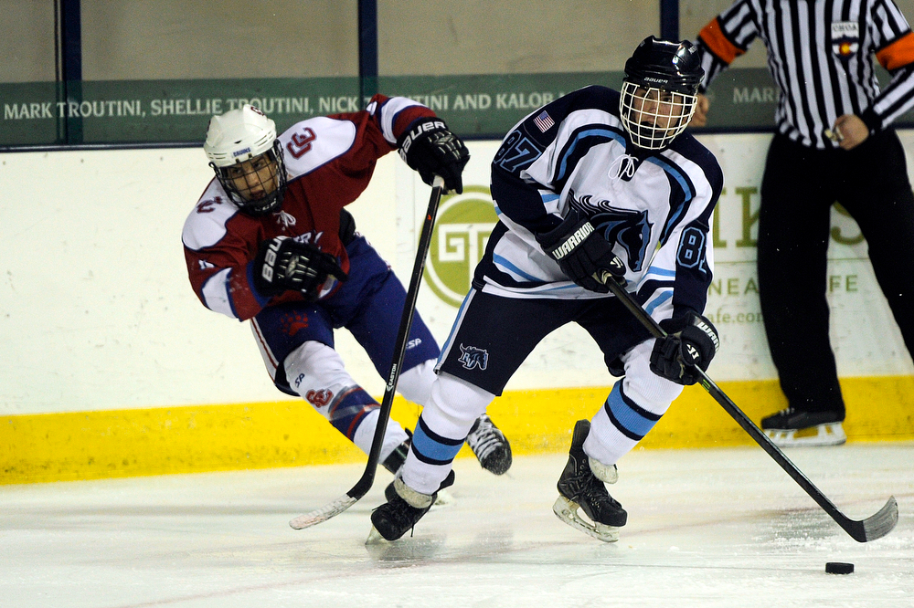 . Tyler Morpurgo (right) of Ralston Valley looks to pass against Cherry Creek in a CHSAA ice hockey semifinal at the Denver Coliseum on February 28, 2014, in Denver, Colorado. Ralston Valley won 6-2. (Photo by Daniel Petty/The Denver Post)