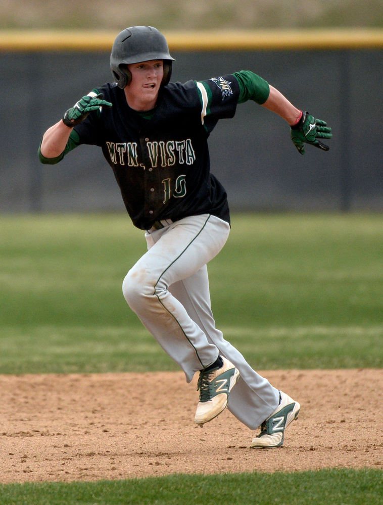 . Mountain Vista baserunner Michael Dunnebecke headed to third base in the fifth inning. The Mountain Vista High School baseball team blanked ThunderRidge 3-0 Wednesday afternoon, April 16, 2014. (Photo by Karl Gehring/The Denver Post)