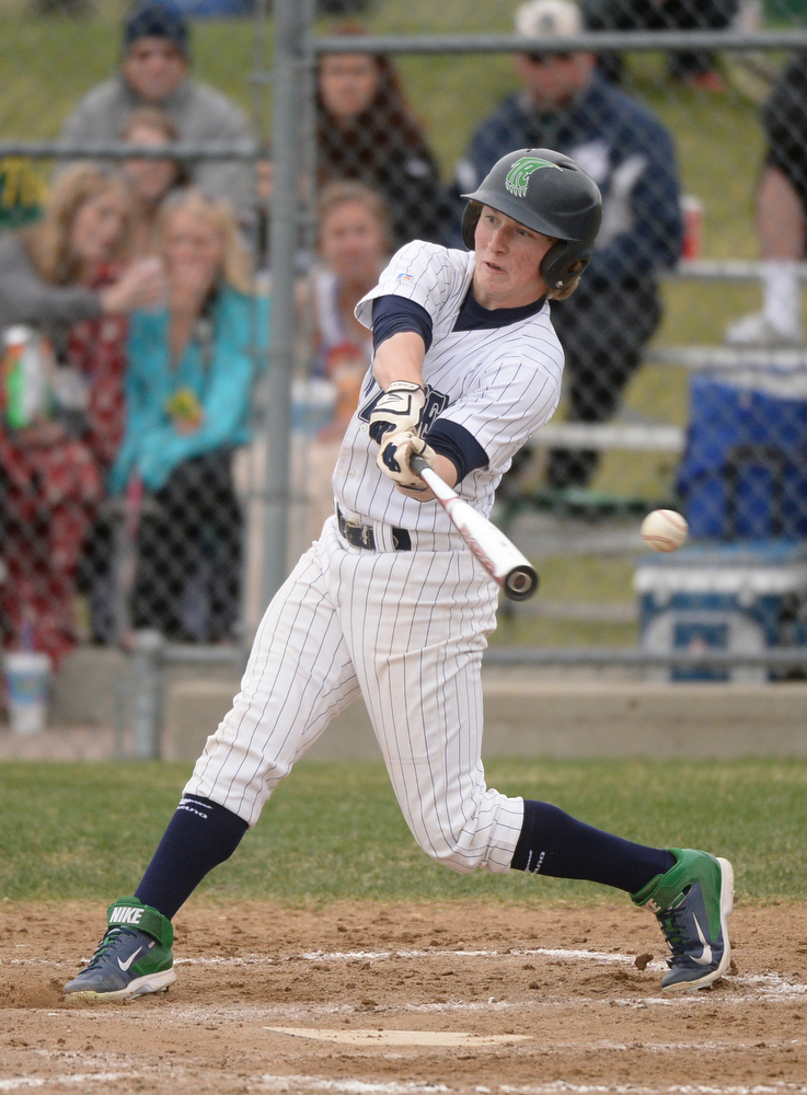 . ThunderRidge batter Aaron Germani swung and missed to strike out in the third inning. The Mountain Vista High School baseball team blanked ThunderRidge 3-0 Wednesday afternoon, April 16, 2014. (Photo by Karl Gehring/The Denver Post)