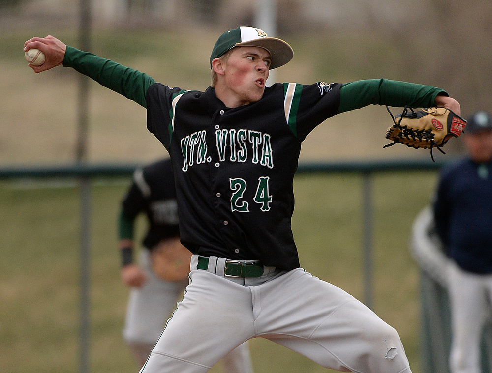 . Golden Eagles pitcher Nick Leonard delivered to the plate in the ninth inning. Leonard threw a complete game shutout. The Mountain Vista High School baseball team blanked ThunderRidge 3-0 Wednesday afternoon, April 16, 2014. (Photo by Karl Gehring/The Denver Post)