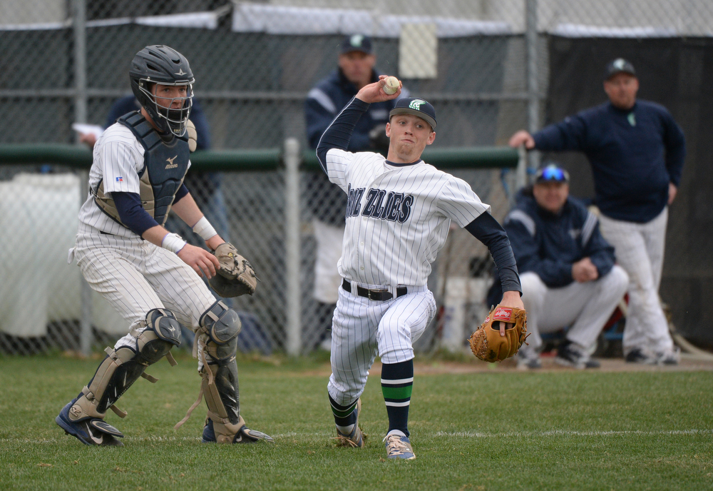 . Grizzlies pitcher AJ Jones threw out Mountain Vista\'s Jack Strunc who put down a bunt to advance base runners in the sixth inning. The Mountain Vista High School baseball team blanked ThunderRidge 3-0 Wednesday afternoon, April 16, 2014. (Photo by Karl Gehring/The Denver Post)