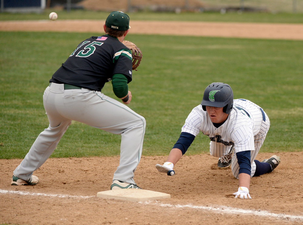 . Grizzlies baserunner Josh Brown hustled back to the bag on a pick-off attempt in the fifth inning. The Mountain Vista High School baseball team blanked ThunderRidge 3-0 Wednesday afternoon, April 16, 2014. (Photo by Karl Gehring/The Denver Post)