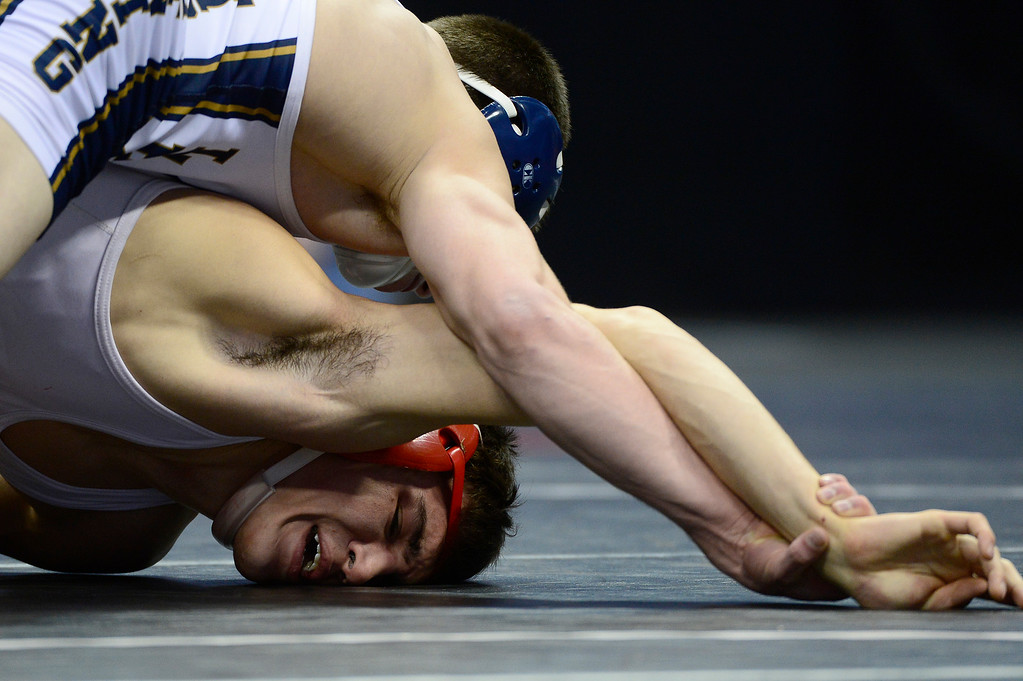 . David Kavanagh of Denver East tries to push up off the mat while Ryan Deakin of Legacy tries to flip him for a pin during the final round of the Class 5A 138 pound division during the finals of the 2016 Colorado Wrestling State Championships at the Pepsi Center on February 20, 2016 in Denver, Colorado. (Photo by Brent Lewis/The Denver Post)