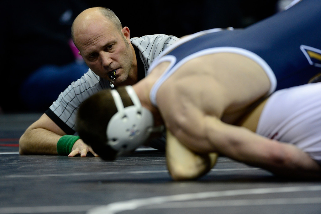 . A referee watches for the pin while Ryan Deakin of Legacy tries to roll over David Kavanagh of Denver East during the final round of the Class 5A 138 pound division during the finals of the 2016 Colorado Wrestling State Championships at the Pepsi Center on February 20, 2016 in Denver, Colorado. (Photo by Brent Lewis/The Denver Post)