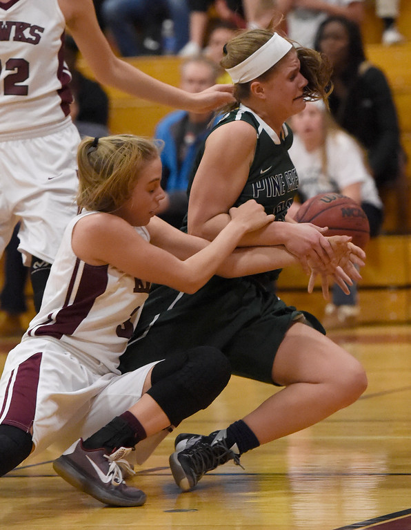 . THORNTON, CO - MARCH 01: Pine Creek Spencer Lindsey (23) gets pulled by the arm by Horizon Kylie Jimenez (3) during the Girls Class 5A Sweet 16 game March 1, 2016 at Horizon HS. (Photo By John Leyba/The Denver Post)