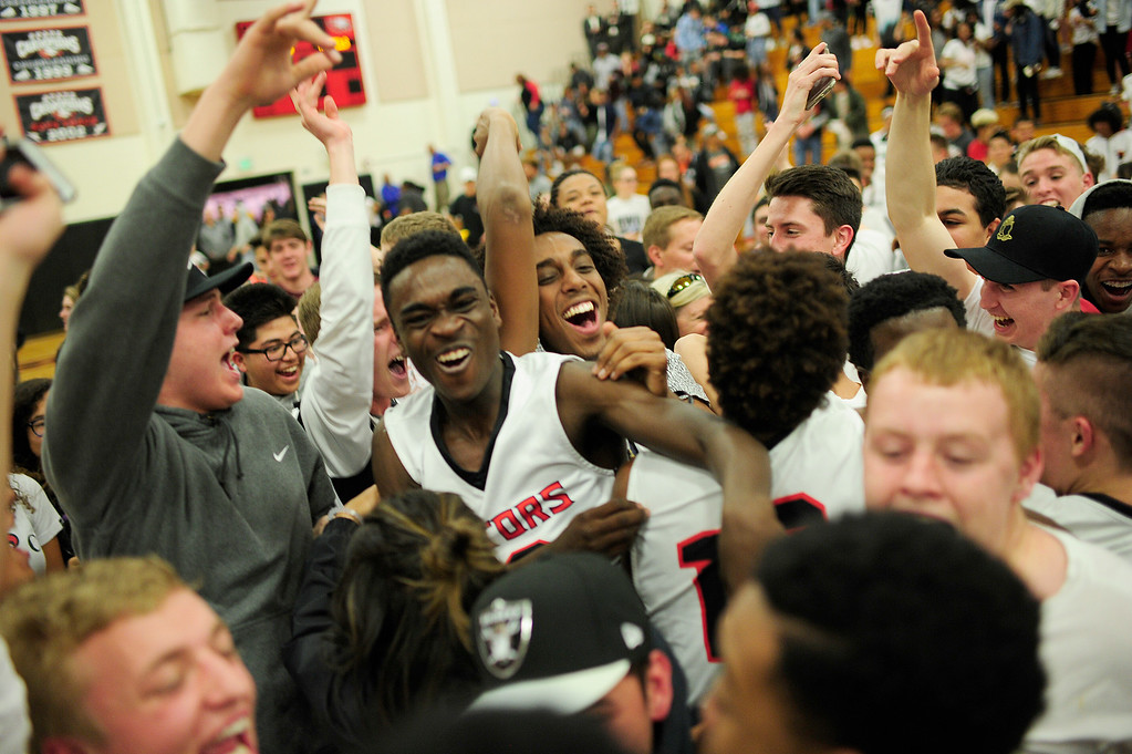 . CENTENNIAL, CO - MARCH 2: Eaglecrest players and fans celebrate after they defeated Denver East at Eaglecrest High School on March 2, 2016 in Centennial, Colorado. Eaglecrest defeated Denver East 56-46. (Photo by Brent Lewis/The Denver Post)