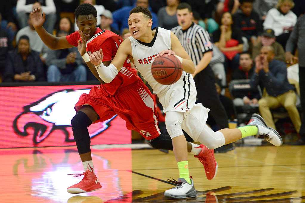 . CENTENNIAL, CO - MARCH 2: Joseph Abiakam (12) of Denver East makes contact with Colbey Ross (1) of Eaglecrest during the fourth quarter at Eaglecrest High School on March 2, 2016 in Centennial, Colorado. Eaglecrest defeated Denver East 56-46. (Photo by Brent Lewis/The Denver Post)