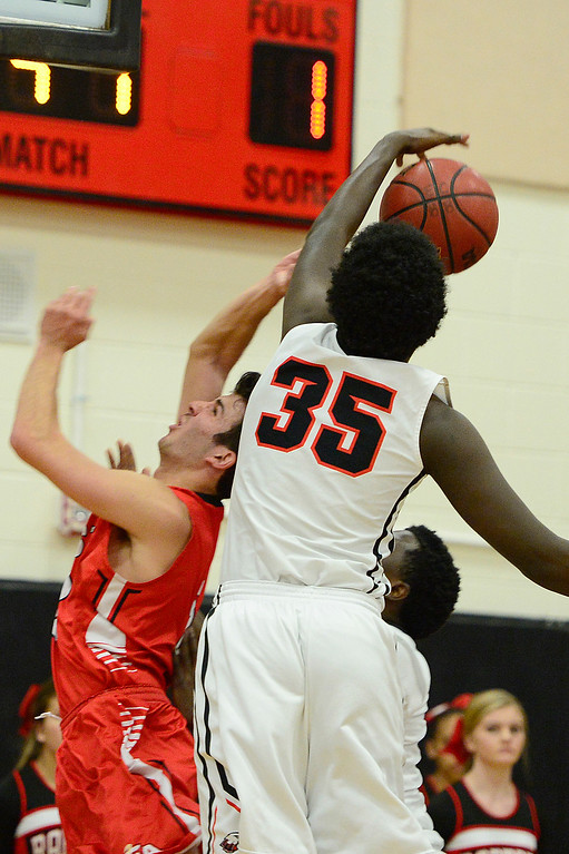 . CENTENNIAL, CO - MARCH 2: Jack Buckmelter of Denver East (2) get his shot blocked by Josh Walton of Eaglecrest (35) during the first quarter at Eaglecrest High School on March 2, 2016 in Centennial, Colorado. Eaglecrest defeated Denver East 56-46. (Photo by Brent Lewis/The Denver Post)