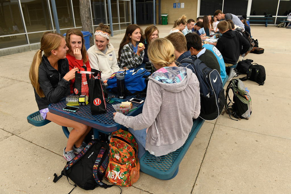. COLORADO SPRINGS, CO - MAY 10:  Runner Katie Rainsberger has lunch with friends in the main courtyard during school at Air Academy High School on the Air Force Academy campus at on May 10, 2016 in Colorado Springs, Colorado. (Photo by Helen H. Richardson/The Denver Post)