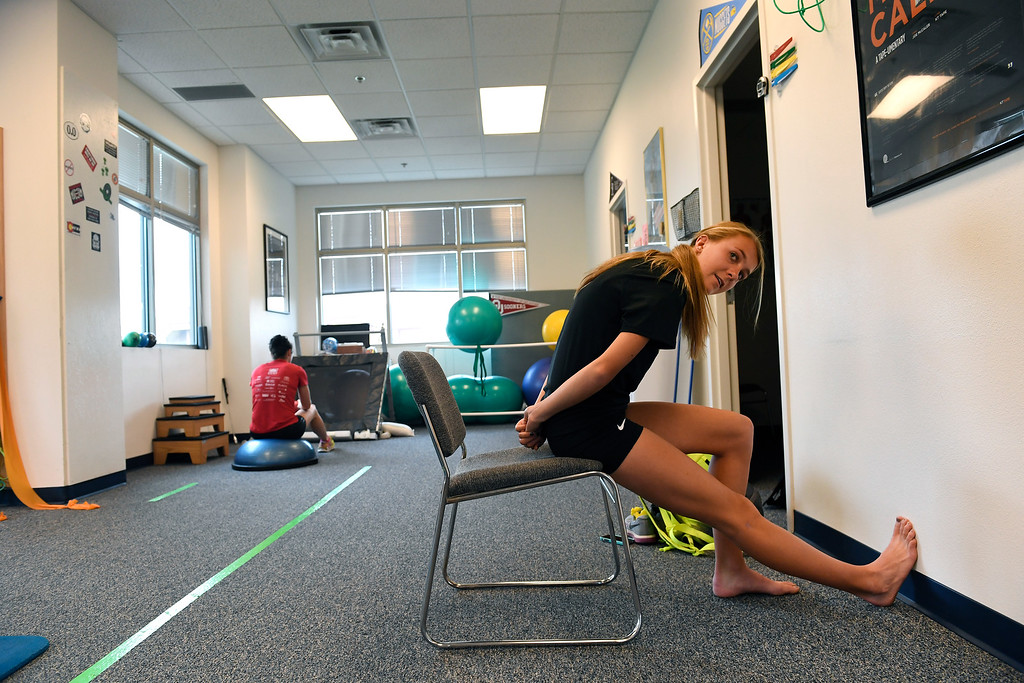 . COLORADO SPRINGS, CO - MAY 10:  Runner Katie Rainsberger stretches before having physical therapy at Action Potential Physical Therapy on May 10, 2016 in Colorado Springs, Colorado. Rainsberger gets PT once a week as  maintenance so as not to get injured and tackle any aches or pains before they turn into injuries. (Photo by Helen H. Richardson/The Denver Post)