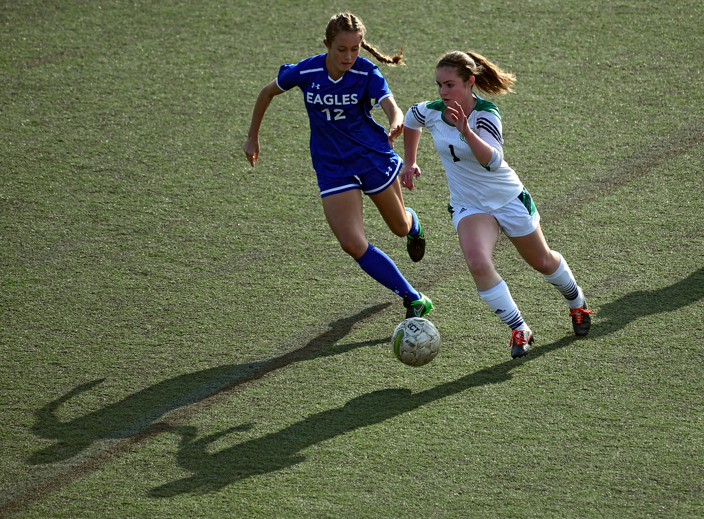 . HIGHLANDS RANCH, CO - MAY 18: ThunderRidge Katelyn Barner (1) and Broomfield Tessa Wagner (12) chase after the ball during the second half in girls quarterfinals May 18, 2016 at Shea Stadium. Broomfield defeated ThunderRidge 2-0. (Photo By John Leyba/The Denver Post)