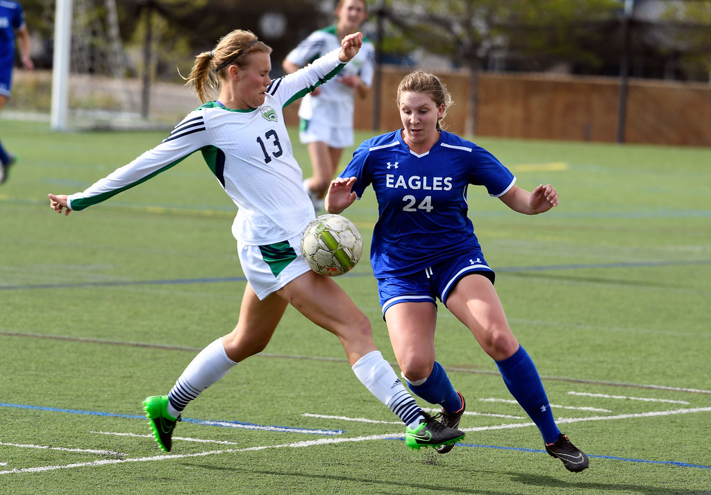 . HIGHLANDS RANCH, CO - MAY 18: Broomfield Michaela Stark (24) and ThunderRidge Amanda Chamness (13) go after the ball during the first half in girls quarterfinals May 18, 2016 at Shea Stadium. (Photo By John Leyba/The Denver Post)