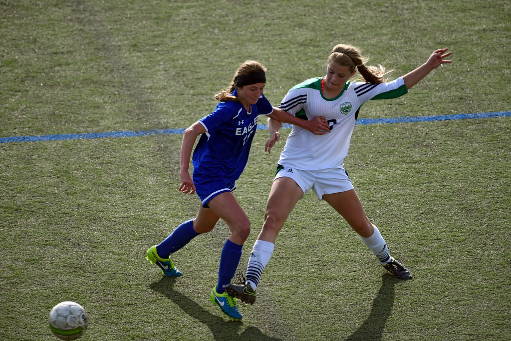 . HIGHLANDS RANCH, CO - MAY 18: ThunderRidge Maddie Duren (9) kicks the ball away from Broomfield Hailey Stolen (19) during the second half in girls quarterfinals May 18, 2016 at Shea Stadium. Broomfield defeated ThunderRidge 2-0. (Photo By John Leyba/The Denver Post)