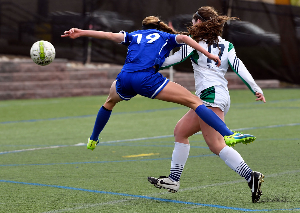 . HIGHLANDS RANCH, CO - MAY 18: Broomfield Hailey Stodden (19) gets off a shot on goal for a score as ThunderRidge Bellingham Payton (17) looks on during the first half in girls quarterfinals May 18, 2016 at Shea Stadium. (Photo By John Leyba/The Denver Post)