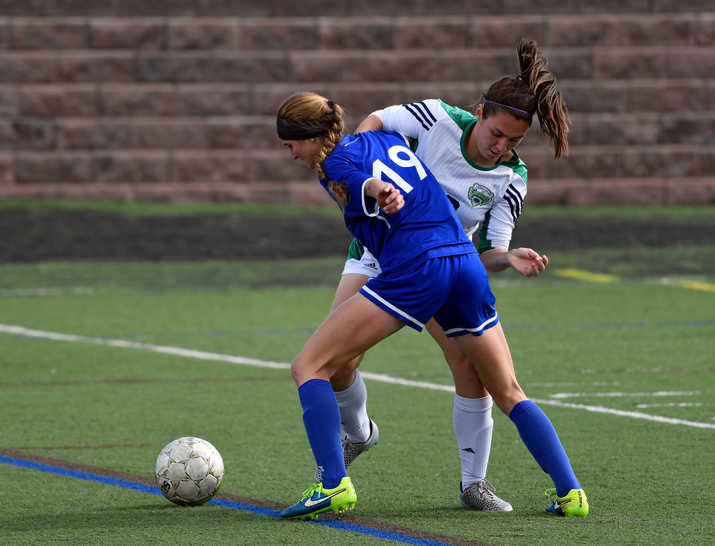 . HIGHLANDS RANCH, CO - MAY 18: Broomfield Hailey Stodden (19) and ThunderRidge Danielle Meuret (18) battle for the ball during the first half in girls quarterfinals May 18, 2016 at Shea Stadium. (Photo By John Leyba/The Denver Post)