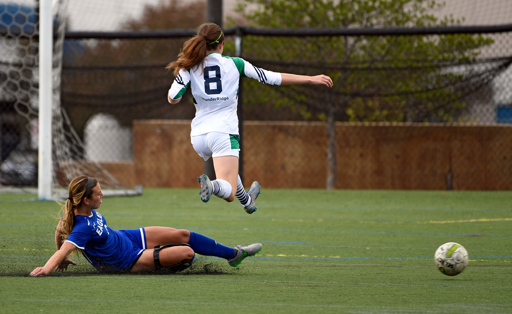 . HIGHLANDS RANCH, CO - MAY 18: Broomfield Zoe Zinis (9) kicks the ball away from ThunderRidge Tucker Kaley (8) during the first half in girls quarterfinals May 18, 2016 at Shea Stadium. (Photo By John Leyba/The Denver Post)