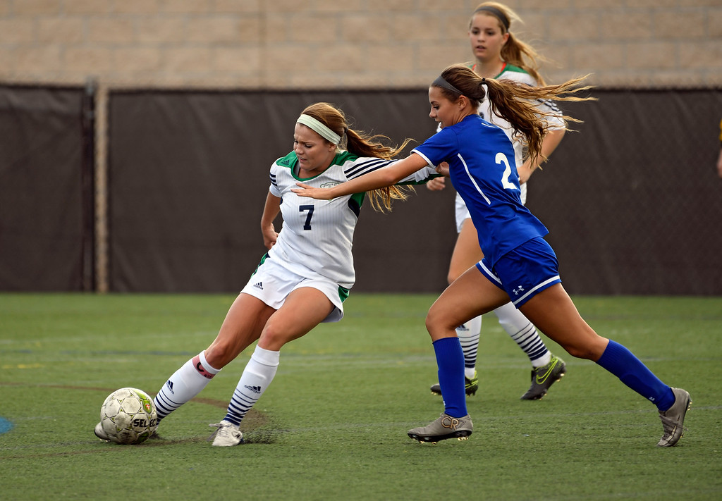 . HIGHLANDS RANCH, CO - MAY 18: ThunderRidge Kylee Duren (7) kicks the ball out from Broomfield Jordan Goodwin (2) during the first half in girls quarterfinals May 18, 2016 at Shea Stadium. (Photo By John Leyba/The Denver Post)