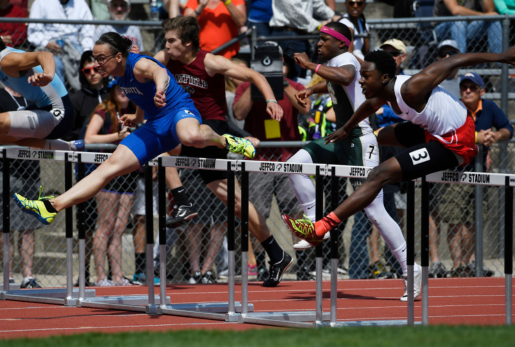 . LAKEWOOD, CO - May 19: Jacob Hahn, Fruita Monument, left, and Joesph Abiakam, right, clear a hurdle during the boys 5A 110 meter hurdles preliminary race during the first day of the  Colorado State High School Track and Field Championships at Jeffco Stadium May 19, 2016. (Photo by Andy Cross/The Denver Post)