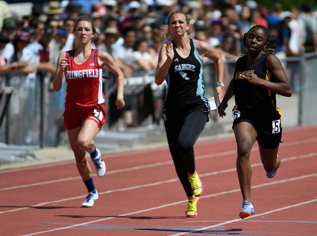 . Zariah Mason; Kim High School, right, heads down track ahead of competitors Audrey Rau, left, Springfield, and Sarah Storey, Sangre de Cristo, winning the 1A 100 meter dash final, but wasn\'t happy with her time that didn\'t set a new record at the Colorado Track and Field State Championships at Jeffco Stadium May 21, 2016. (Photo by Andy Cross/The Denver Post)