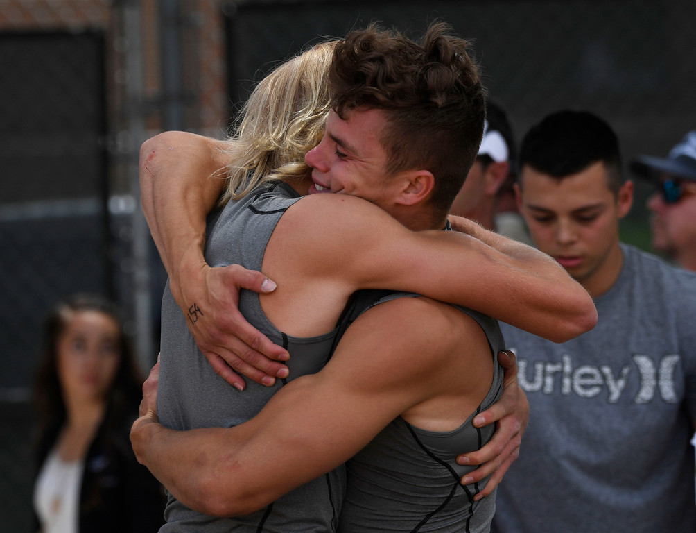. Ramon Salgado, Mountain View, right, hugs his teammate Brenton Emmons, left, after winning the boys 4A pole vault completion despite a leg injury at the Colorado Track and Field State Championships at Jeffco Stadium May 21, 2016. Salgado won the event with a vault of 14\' 8 inches. (Photo by Andy Cross/The Denver Post)