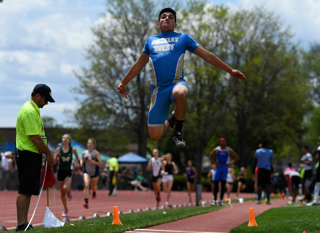 . LAKEWOOD, CO - May 19: Zac Bitton, Greeley West, flies high during the boys 5A long jump competition finals at the Colorado State High School Track and Field Championships at Jeffco Stadium May 19, 2016. (Photo by Andy Cross/The Denver Post)