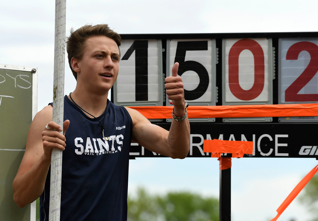 ". LAKEWOOD, CO - May 20: Cooper Daniels, Vail Christian High School, poses next to the sign that posted her record vault of 15\' 2""  a new state record in the boys 2A vault event at the Colorado State High School Track and Field Championships at Jeffco Stadium May 20, 2016. (Photo by Andy Cross/The Denver Post)"