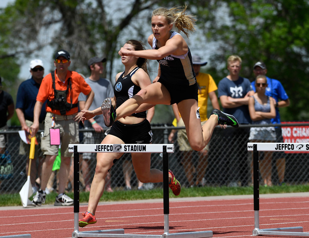 . Emily Sloan, Rock Canyon, clears a hurdle on her way to victory in the girls 5A 300 meter hurdles at the Colorado Track and Field State Championships at Jeffco Stadium May 21, 2016. Sloan won with a time of 41.24  (Photo by Andy Cross/The Denver Post)