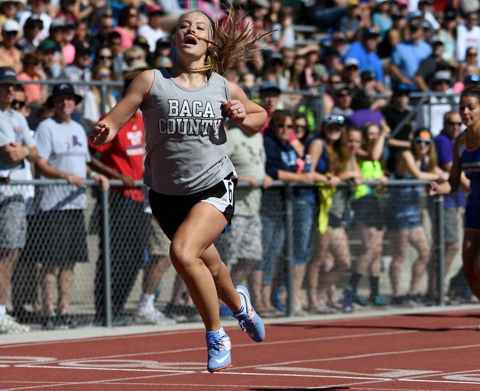 . Ciara Tate, Baca County, moments after crossing the finish line in first place to win the girls 1A 100 meter hurdles final at the Colorado Track and Field State Championships at Jeffco Stadium May 21, 2016. (Photo by Andy Cross/The Denver Post)