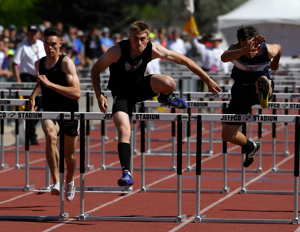 . Matt Hanson, Lutheran, center, clears the last hurdle on his way to winning the 3A 110 meter hurdles at the Colorado Track and Field State Championships at Jeffco Stadium May 21, 2016. (Photo by Andy Cross/The Denver Post)