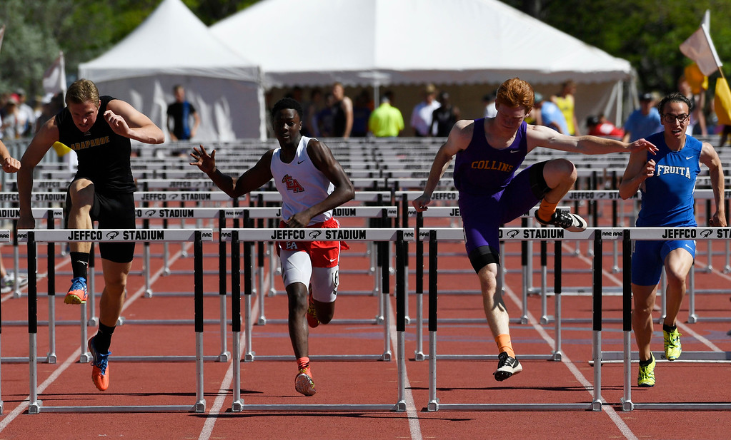 . Thomas Robillard, Ft. Collins, third from left, clears the last hurdle as competitors Ray Hass, Arapahoe, left, Joseph Abiakam, Denver East, second from left, and Jacob Hahn, Fruita Monument, right, are close in the 5A 110 meter hurdles final at the Colorado Track and Field State Championships at Jeffco Stadium May 21, 2016. Robillard won with a time of 14.48 (Photo by Andy Cross/The Denver Post)