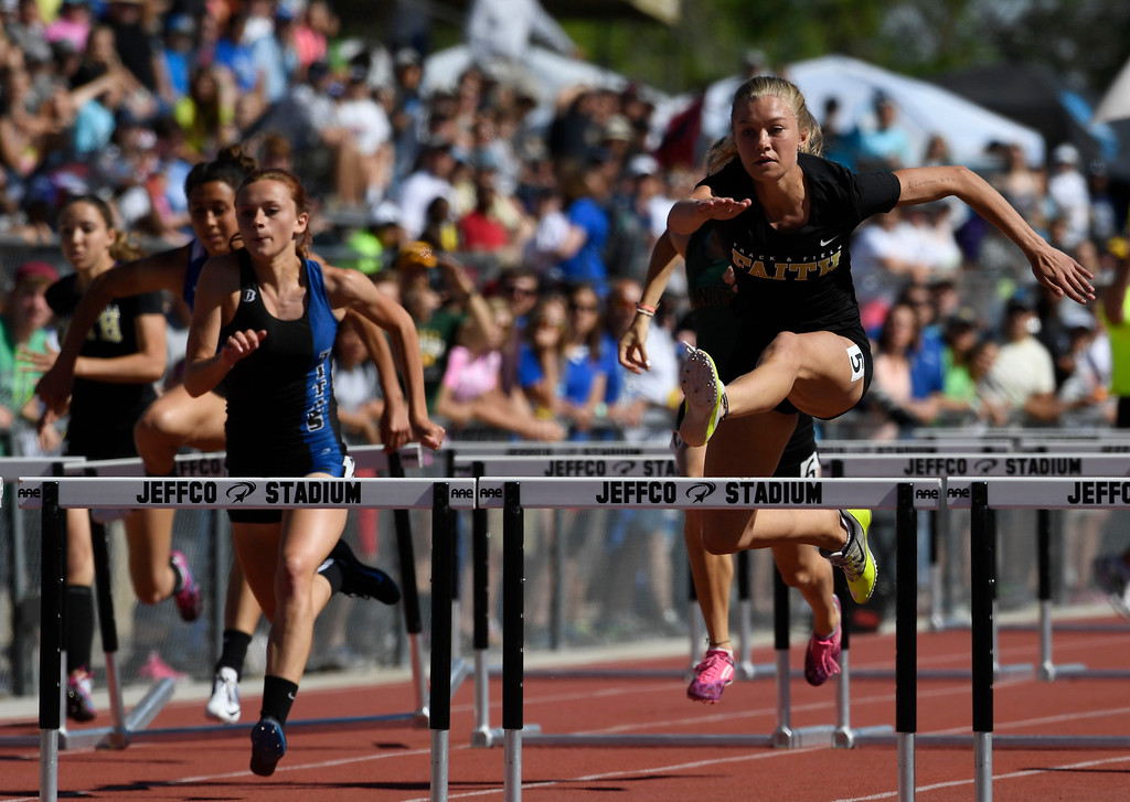. Sarah Yocum, Faith Christian, right, clears the last hurdle on her way to win the girls 3A 100 meter hurdles final at the Colorado Track and Field State Championships at Jeffco Stadium May 21, 2016. (Photo by Andy Cross/The Denver Post)