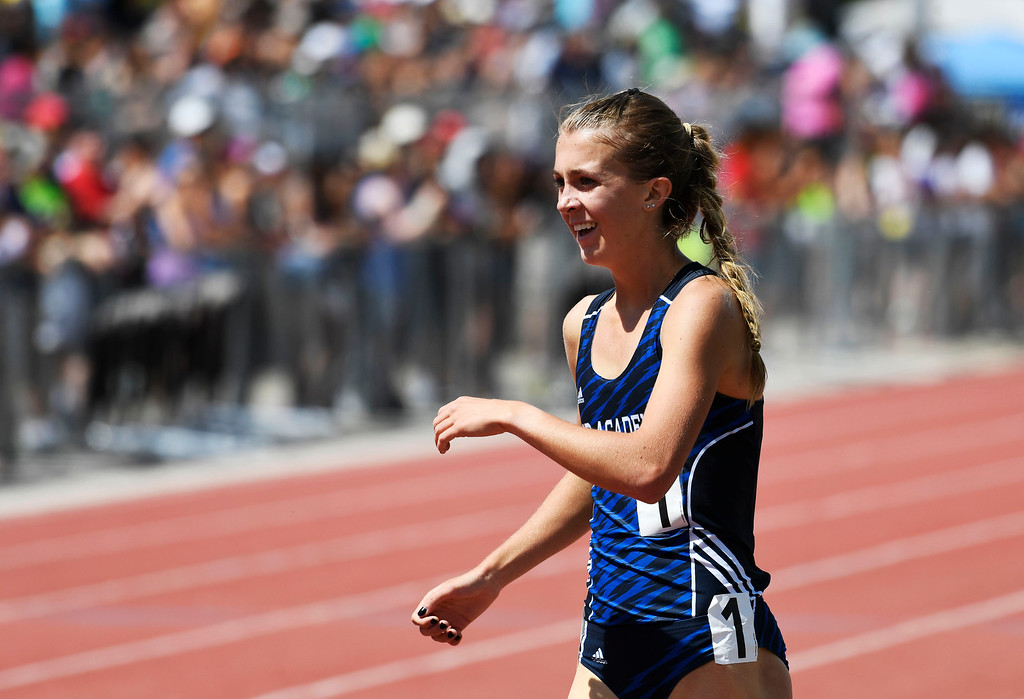 . Katie Rainsberger, Air Academy, cracks a smile after winning the girls 4A 1600 meter run at the Colorado Track and Field State Championships at Jeffco Stadium May 21, 2016. Rainsberger won the event with a time of 4:45. 27 setting a new meet record. (Photo by Andy Cross/The Denver Post)