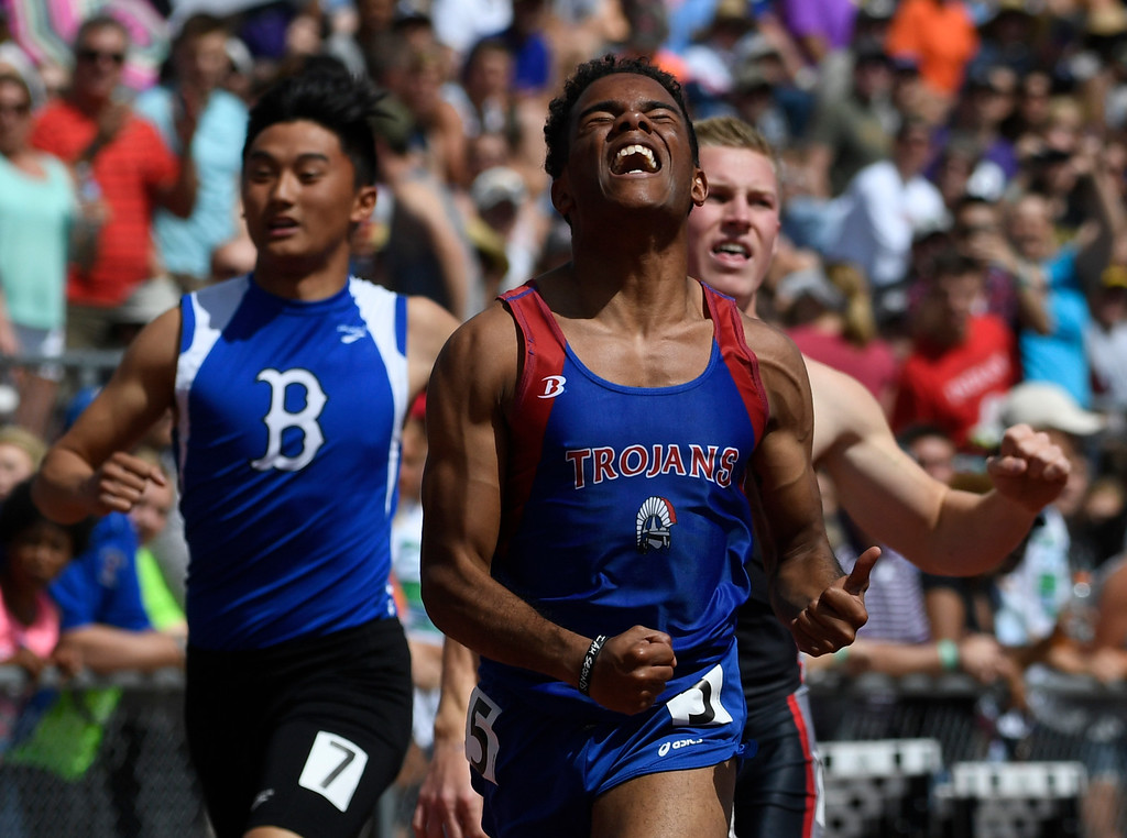 . Christian Lyon, Fountain-Ft. Carson, celebrates his boys 5A 100 meter dash final at the Colorado Track and Field State Championships at Jeffco Stadium May 21, 2016. Lyon won with a time of 10.80  (Photo by Andy Cross/The Denver Post)