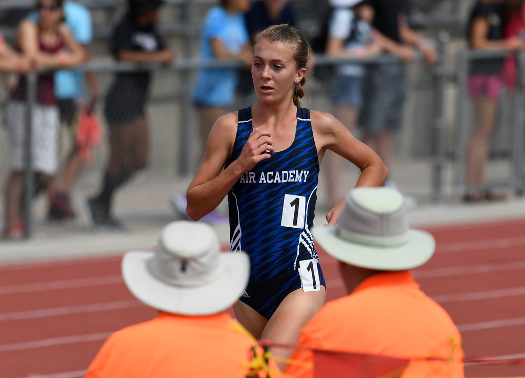 . LAKEWOOD, CO - May 20: Katie Rainsberger, Air Academy, makes her way down the front stretch past two officials during the girls 4A 32000 meter final run at the Colorado State High School Track and Field Championships at Jeffco Stadium May 20, 2016. Rainsberger won the event with a time of 10:23.24 (Photo by Andy Cross/The Denver Post)