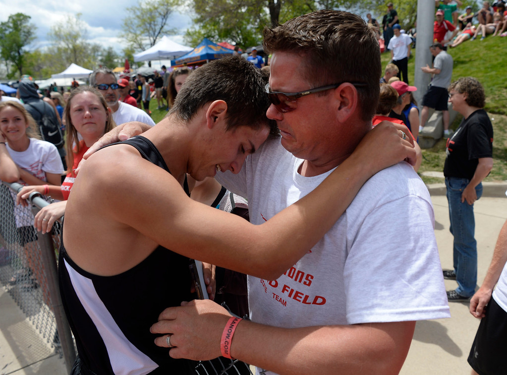 . LAKEWOOD, CO - May 20: David Moenning, left, brings his father Joshua, to tears after edging out Thomas Staines, (not pictured) Cheyenne Mountain winning the boys 4A 800 meter run final at the Colorado State High School Track and Field Championships at Jeffco Stadium May 20, 2016. Moenning won with a time of 1:52.26 (Photo by Andy Cross/The Denver Post)