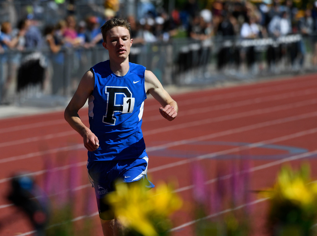 . LAKEWOOD, CO - May 19: Henry Raymond, Poudre High School, crosses the finish line in first place to win the boys 5A 3200 meter run at the Colorado State High School Track and Field Championships at Jeffco Stadium May 19, 2016. Raymond won with a time of 9:25:21 (Photo by Andy Cross/The Denver Post)