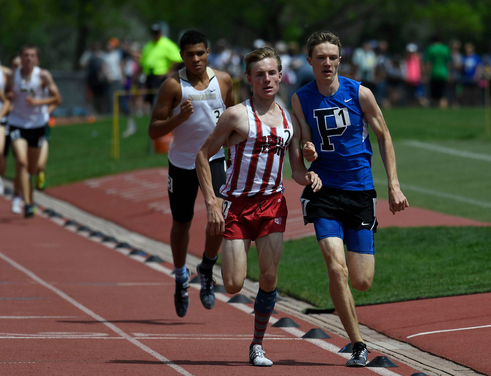 . Henry Raymond, Poudre, right, and competitor Jack Davidson, Regis Jesuit, brush elbows battling for position during the boys 5A 1600 meter run final at the Colorado Track and Field State Championships at Jeffco Stadium May 21, 2016. Raymond won the event with a time of 4:18.67 (Photo by Andy Cross/The Denver Post)