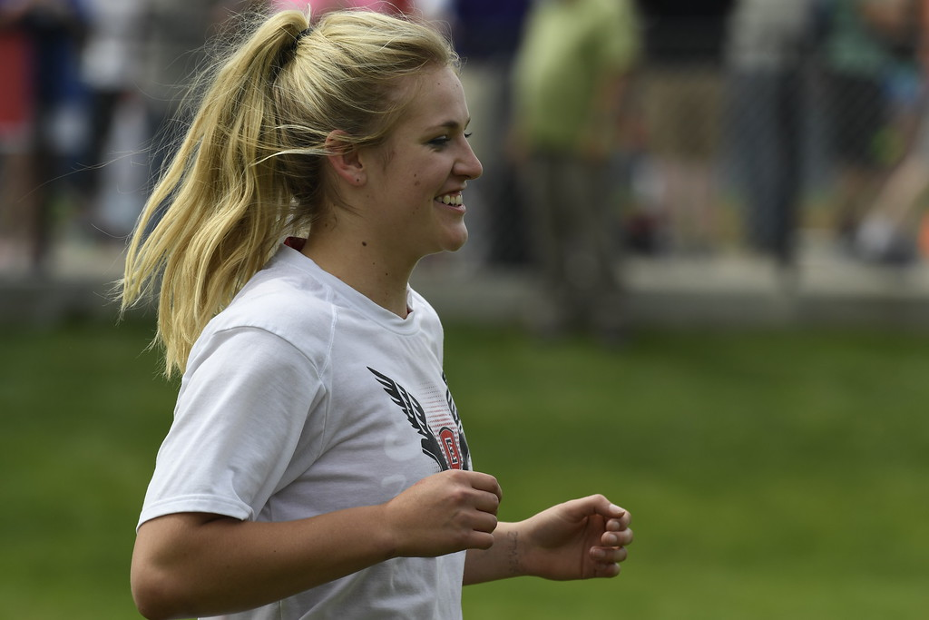 ". LAKEWOOD, CO - May 20: Discus thrower Tarynn Sieg, Eaton Reds, is all smiles during warm-ups for the girls 3A discus throw at the Colorado State High School Track and Field Championships at Jeffco Stadium May 20, 2016. Sing went on to win a throw of 142\' 10"" (Photo by Andy Cross/The Denver Post)"