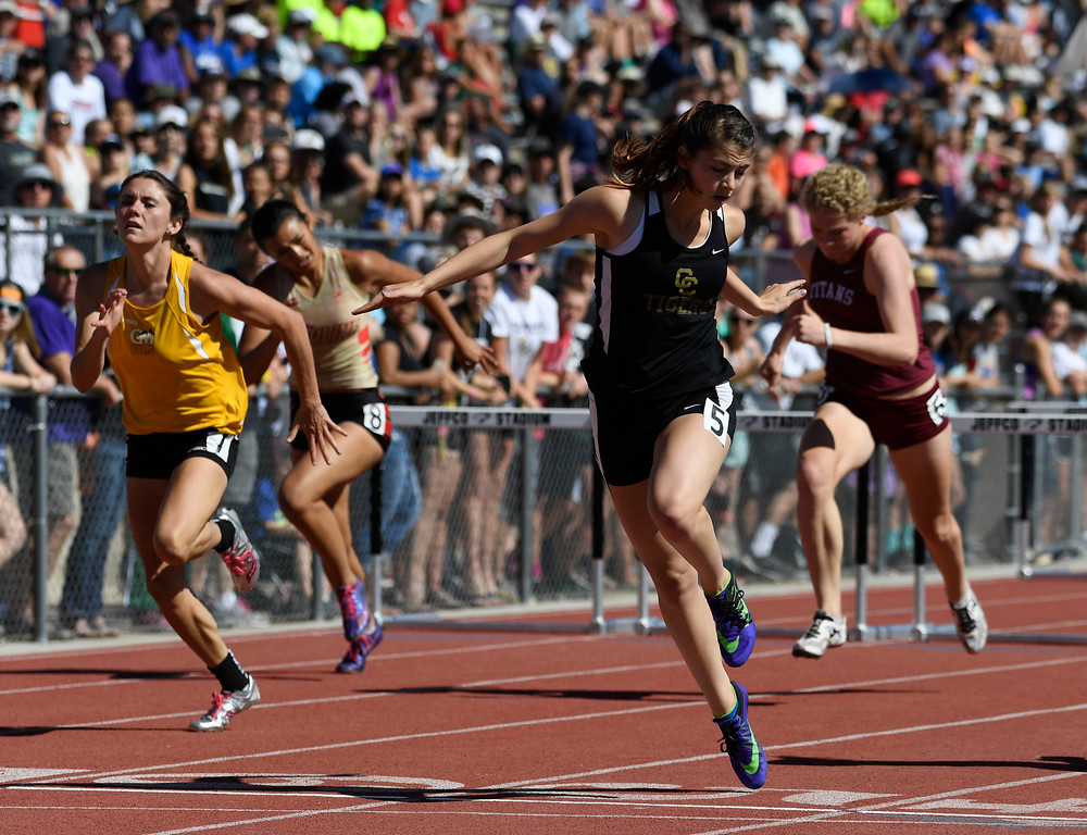 . Alexis Buckhaults, Canon City, crosses the finish line in first to win the girls 4A 100 meter hurdles final at the Colorado Track and Field State Championships at Jeffco Stadium May 21, 2016. (Photo by Andy Cross/The Denver Post)